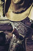 image of projectile  - gun and hat outdoor under sunlight - JPG