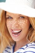stock photo of flirty  - Portrait of flirty woman in summer hat - JPG