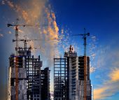 picture of land development  - building construction site against beautiful blue sky use for construction industry and multipurpose of real estate business