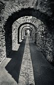 picture of arcade  - Old stone arcade, corridor in castl. Monochrome  photo.