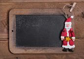 pic of nicholas  - Chalk board for Merry Christmas message santa on wooden background for a greeting card  - JPG