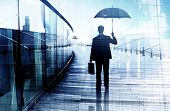 stock photo of struggle  - Depressed Businessman Standing While Holding an Umbrella - JPG