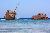 pic of shipwreck  - A rusting metal shipwreck aground on a tropical coral reef - JPG