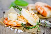 pic of tiger prawn  - grilled prawns with rosemary close up on wooden table - JPG