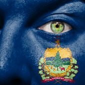 picture of burlington  - Flag painted on face with green eye to show Vermont support - JPG