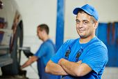 foto of assemblage  - repairman auto mechanic Portrait in car auto repair or maintenance shop service station - JPG