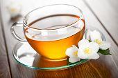 stock photo of jasmine  - Jasmine tea with jasmine flower on table background - JPG