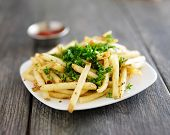 stock photo of truffle  - plate of truffle fries with parsley spread - JPG