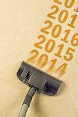 foto of new year 2014  - Vacuum Cleaner sweeping year number 2014 from Brand New Carpet leaving sequence 2015 2016 - JPG