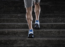 foto of calf  - Close up of young man running up th stairs - JPG