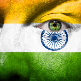 stock photo of ashok  - Flag painted on face with green eye to show india support - JPG