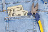 foto of denim jeans  - Money and tool in blue jeans pocket - JPG