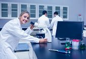 stock photo of microscopes  - Science student working with microscope in the lab at the university - JPG