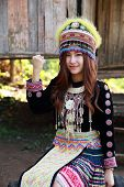 picture of hmong  - Traditionally dressed Mhong hill tribe woman at the wooden cottage - JPG