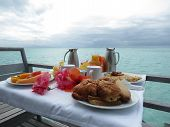 stock photo of french polynesia  - Delicious and colorful breakfast on a balcony in Bora Bora - JPG