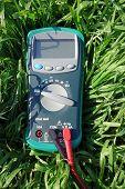 foto of  multimeter  - the Digital multimeter under a bright sunlight - JPG