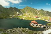stock photo of chalet  - Balea Lake and chalet in Romania Fagaras mountains - JPG