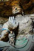 picture of enormous  - an enormous bodhisattva sitting in a huge cave in Yungang Grotto in China - JPG