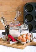 image of cake-mixer  - Baking cake ingredients and cooking tools over wooden surface - JPG