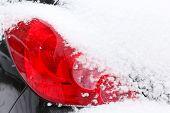 foto of headlight  - Car headlight in snow - JPG