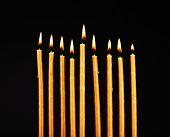 stock photo of menorah  - Hanukkah menorah with candles isolated on black - JPG