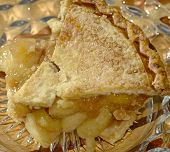 stock photo of crust  - A sweet crumbly apple pie with the apples spilling out of the crust - JPG