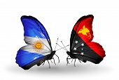 foto of papua new guinea  - Two butterflies with flags on wings as symbol of relations Argentina and Papua New Guinea - JPG