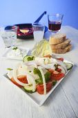 stock photo of ouzo  - greek salad with florini peppers on white - JPG