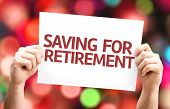 stock photo of retirement  - Saving for Retirement card with colorful background with defocused lights - JPG