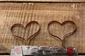 picture of magnetic tape  - Audio cassette with magnetic tape in shape of hearts on wooden background - JPG