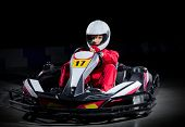 stock photo of armored car  - Young girl karting driver isolated - JPG