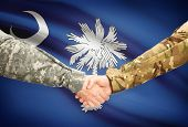 picture of south american flag  - Soldiers handshake and US state flag  - JPG