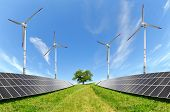 stock photo of turbines  - Solar energy panels and wind turbines on meadow - JPG