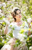 pic of japan girl  - Portrait of beautiful girl posing outdoor with flowers of the cherry trees in blossom during a bright spring day - JPG