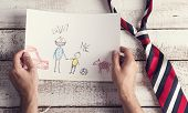 picture of backround  - Fathers day composition with childs drawing and colorful tie laid on wooden desk backround - JPG