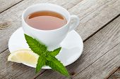 foto of mint-green  - Green tea with lemon and mint on wooden table background with copy space - JPG