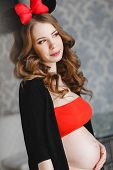 pic of hair bow  - Young beautiful pregnant woman - JPG