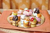 stock photo of cupcakes  - Wedding decoration with colored cupcakes - JPG