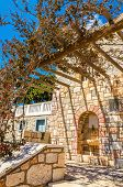 image of stone house  - Pergola in front on typial Greek balcony of stone house in Greece - JPG