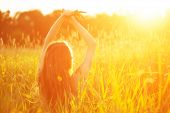 picture of allergy  - Young hipster model woman Casual Girl in field in Sunset in spring, summer landscape background Springtime Summertime. Allergic to pollen of flowers Allergy Backlit Sun Light Autumn Glow Sun Sunshine  - JPG