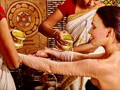 stock photo of panchakarma  - Woman having Ayurvedic spa treatment - JPG