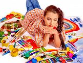 stock photo of crisis  - Unhappy artist woman lying on paint palette - JPG