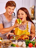 pic of love bite  - Happy couple cooking chicken at kitchen - JPG