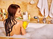 image of bubble-bath  - Woman relaxing at water in bubble bath - JPG