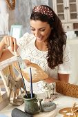 picture of handicrafts  - Young woman enjoying hobby painting - JPG