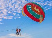 stock photo of parasailing  - Couple parasailing on Batu Feringghi beach in Penang Malaysia  - JPG
