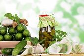 stock photo of pickled vegetables  - Fresh and pickled cucumbers - JPG