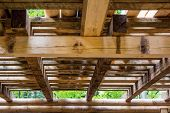 stock photo of tithe  - Interior detail of a wooden beam structure - JPG