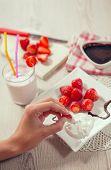 pic of whip-hand  - Fresh strawberries - JPG