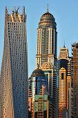 stock photo of emirates  - Skyscrapers in Dubai Marina at sunset - JPG
